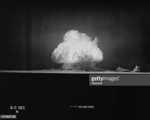 This photo taken at eight seconds after Gadget's detonation at 52945 am shows the tremendous fireball erupting in the early morning sky proving the...
