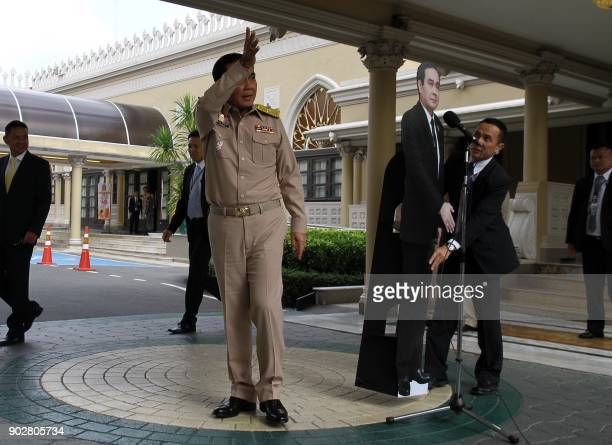 TOPSHOT This photo taken by Dailynews on January 8 2018 shows Thai Prime Minister Prayuth ChanOCha walking away from a press conference after telling...