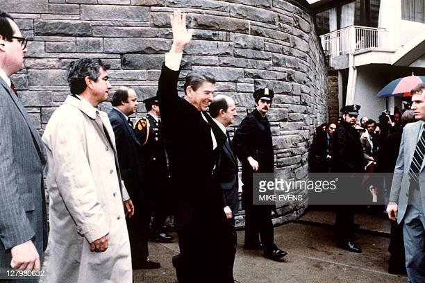 This photo taken by presidential photographer Mike Evens on March 30, 1981 shows President Ronald Reagan waving to the crowd just before the...