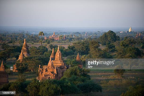 This photo taken December 28 2010 at sunset shows some of the thousands pagodas and temples of Bagan in central Myanmar Once the capital of the first...