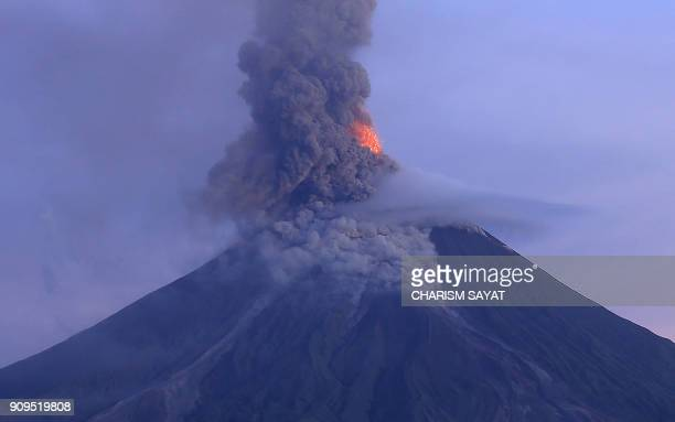 This photo taken from a drone shows a column of ash shooting up from the Mayon volcano as it continues to erupt seen from the city of Legazpi in...