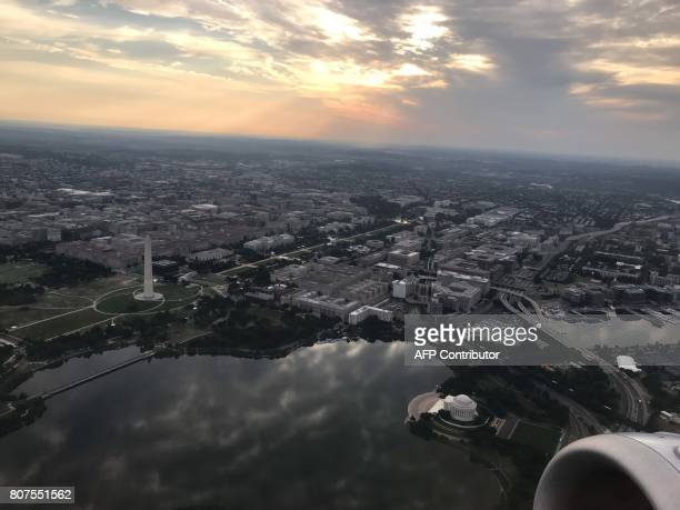 This photo taken from an airplane on July 4 2017 shows a early morning aerial view of Washington DC / AFP PHOTO / Daniel SLIM