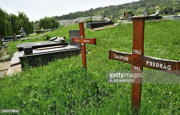 This photo taken in Sarajevo on June 17 2016 shows the grave of Predrag Salipur a 28yearold ethnic Serb who was killed by Musan 'Caco' Topalovic who...