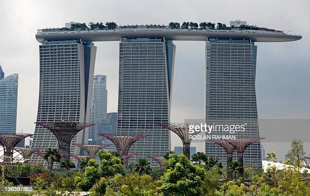 This photo taken in Singapore on January 4, 2012 shows the Marina Bay Sands hotels and sky garden near the Garden by the Bay . Singapore's...