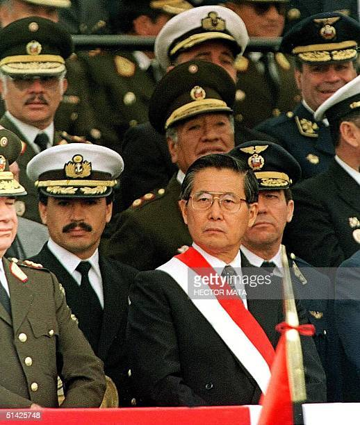This photo taken July 1992 during an appearance by Peruvian President Alberto Fujimori the president is surrounded by members of the military...