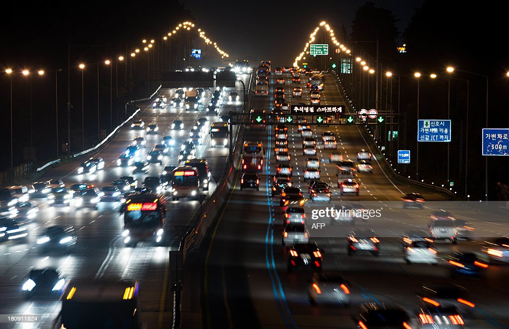 This photo taken late on September 17, 2013 shows traffic departing from and arriving in Seoul over the Kyungbu highway ahead of 'Chuseok', South Korea's biggest holiday, which lasts from September 18 to 20. Approximately 35 million people were expected to travel to their hometowns and villages across the country to visit relatives this year, an increase of 4.9 percent compared with last year's holiday.
