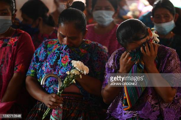 This photo, taken on 30 April 2021, show indigenous women participating in a mass in honour of the victims who died in the Guatemalan village of...