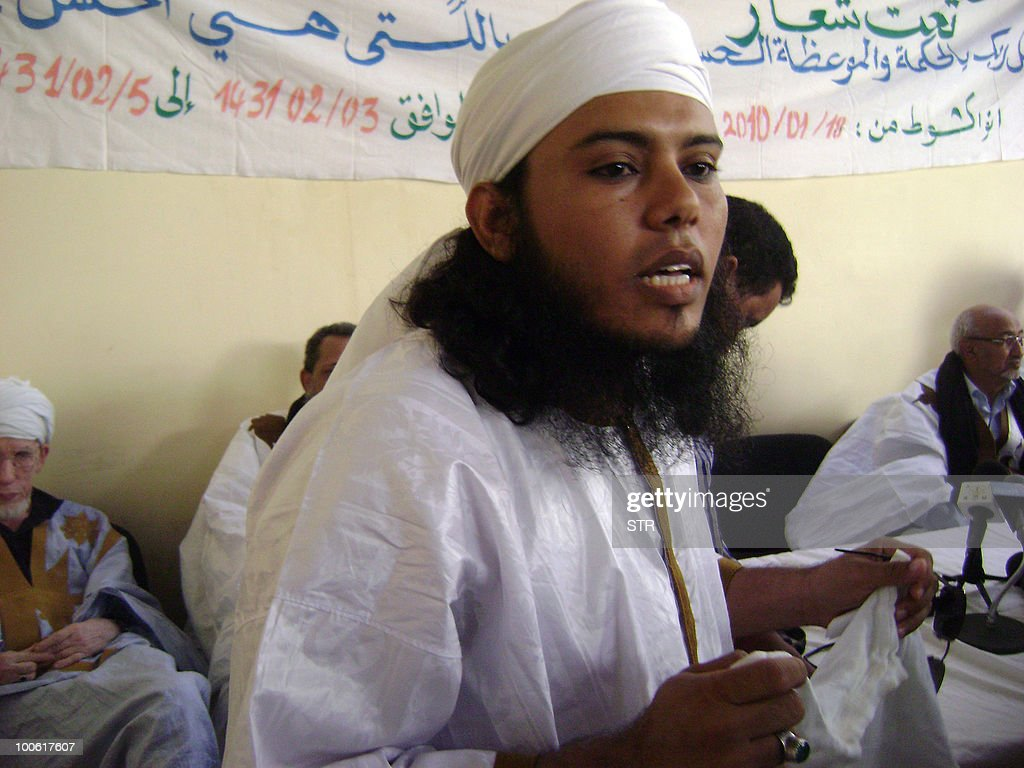 This photo taken on an unspecified date shows Khadim Ould Semane attending a religious meeting at the civil prison in Nouakchott. A Mauritanian court sentenced three Al-Qaeda members to death on May 25, 2010 for the 2007 murder of four French tourists, who responded with threats against France and its president. Mohamed Ould Chabarnou, 29, Maarouf Ould Haiba, 28, and Sidi Ould Sidna, 22, had pleaded not guilty to the murders -- which shocked the visitor-friendly nation -- but presented themselves as 'soldiers of Al-Qaeda'. According to the Interpol website, Sidna was apprehended during an overnight operation in which Khadim Ould Semane, the alleged mastermind of an attack against the Israeli embassy in Nouakchott in February 2008, was also detained.