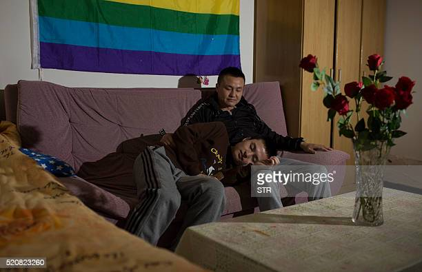 This photo taken on April 12 2016 shows Sun Wenlin and his partner Hu Mingliang sitting on a sofa at their rental house in Changsha central China's...