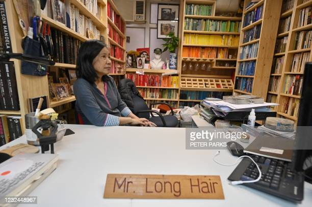 This photo taken on April 12, 2021 shows veteran pro-democracy activist Chan Po-ying sitting at the desk of her husband, Leung Kwok-hung, better...