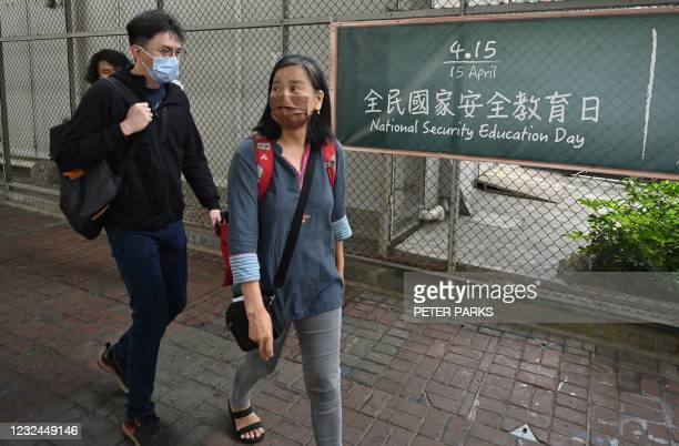 This photo taken on April 12, 2021 shows veteran pro-democracy activist Chan Po-ying going to visit her husband and veteran pro-democracy activist...