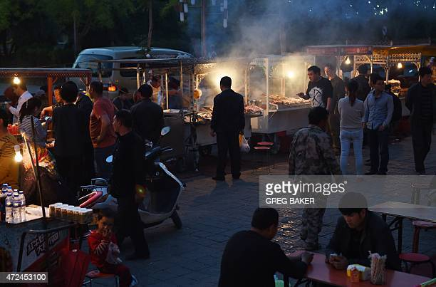 HAAS This photo taken on April 15 2015 shows people at a Uighur night market in Hotan in China's western Xinjiang region Waves of mass immigration...