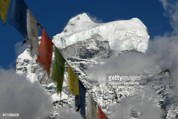 This photo taken on April 16 2018 shows the Himalayan mountain Mount Kangtega from Khumjung village in the Everest region some 140km northeast of...