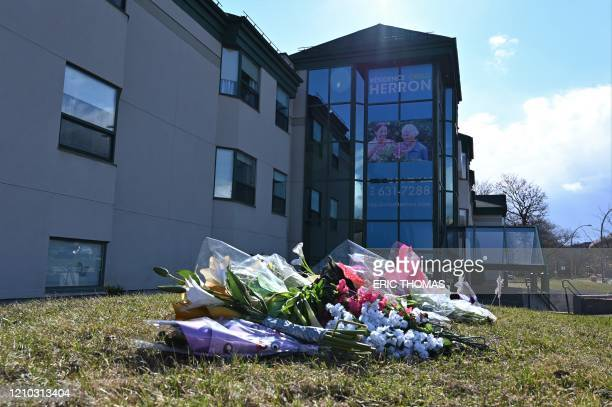 This photo taken on April 16, 2020 shows flowers outside the Herron private nursing home in Dorval, west of Montreal. - The discovery of 31 deaths at...