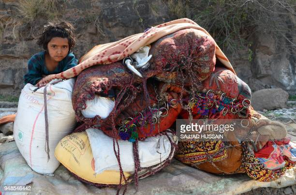 This photo taken on April 18 2018 shows a Kashmiri Muslim Bakarwal nomad sitting at a temporary camp near Udhampur some 72km north of Jammu in...
