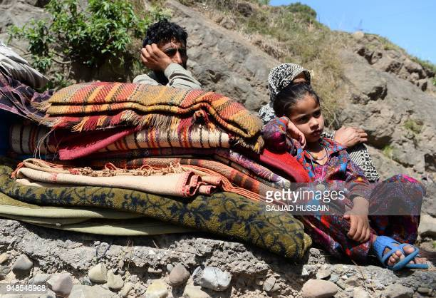 This photo taken on April 18 2018 shows a Kashmiri Muslim Bakarwal family sitting at a temporary camp near Udhampur some 72km north of Jammu in...