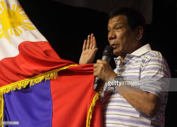 This photo taken on April 19 2016 shows Rodrigo Duterte frontrunner presidential candidate for the May 9 elections swearing in front of a national...