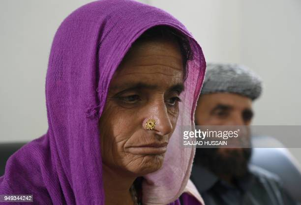 This photo taken on April 19 2018 shows Akthar Hussain biological father of an eightyearold rape and murder victim and her biological mother Rafeeza...