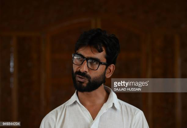 This photo taken on April 19 2018 shows Bakarwal lawyer and social activist Talib Hussain speaking with an AFP reporter during an interview in Jammu...