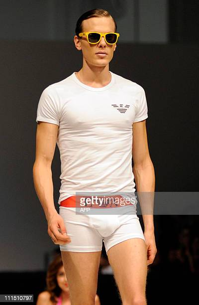 This photo taken on April 2 2011 shows a model showcasing Emporio Armani underwear on day four of the men's fashion week event at the Sands Expo and...