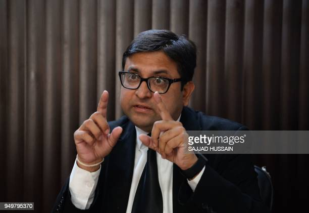 This photo taken on April 20 2018 shows Kirty Bhushan Mahajan president of the Kathua Bar Association speaking with an AFP reporter during an...