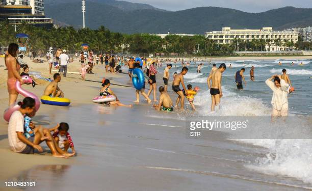 This photo taken on April 20 2020 shows people enjoying the beach in Sanya in China's southern Hainan province / China OUT