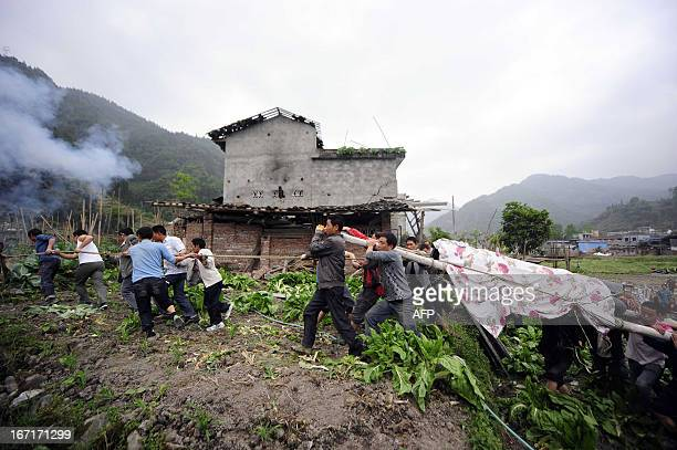 This photo taken on April 21 2013 shows residents carrying a coffin to the grave in disasterhit Ya'an southwest China's Sichuan province Clogged...