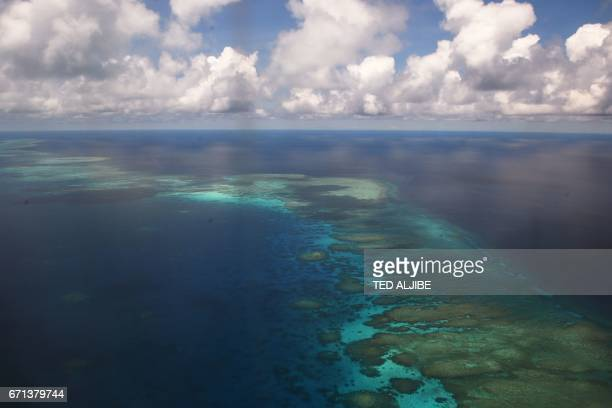 This photo taken on April 21 2017 shows an aerial shot of part of mischief reef in the disputed Spratly islands on April 21 2017 Philippine Defence...