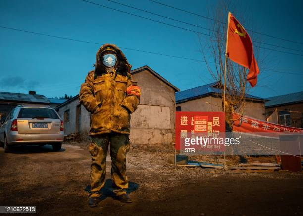 This photo taken on April 21 2020 shows a staff member keeping watch at a checkpoint in the border city of Suifenhe in China's northeastern...