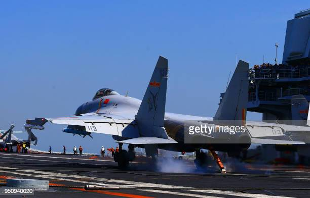 This photo taken on April 24 2018 shows a J15 fighter jet landing on China's sole operational aircraft carrier the Liaoning during a drill at sea A...