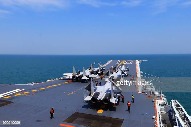 This photo taken on April 24 2018 shows J15 fighter jets on China's sole operational aircraft carrier the Liaoning during a drill at sea A flotilla...