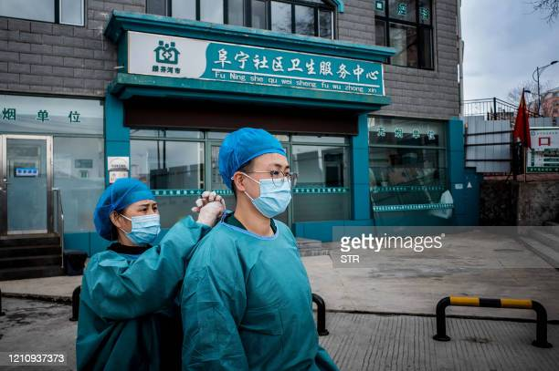 This photo taken on April 24 shows medical personnel in front of a health services centre for nucleic acid testing as part of COVID19 pandemic...