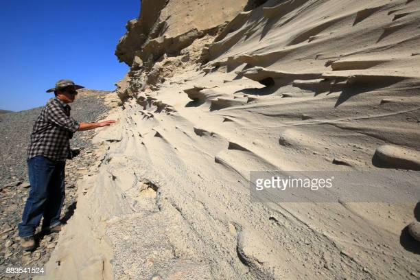 This photo taken on April 25, 2015 shows China's scientist Wang Xiaolin investigating the terrain in Hami, in northwestern China's Xinjiang Region....