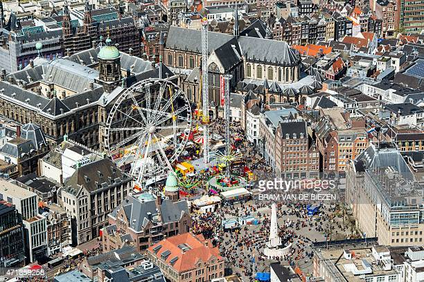This photo taken on April 27 2015 in Amsterdam shows an aerial view of Dam Square during King's Day the celebration of the birthday of the king...