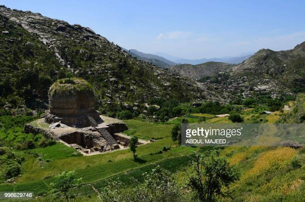 This photo taken on April 27 2018 shows of a centuriesold stupa a domeshaped Buddhist monument in the town of Amluk Dara near Mingora the capital of...
