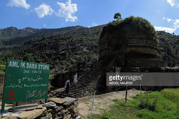 This photo taken on April 27 2018 shows Pakistani visitors arriving to see the centuriesold stupa a domeshaped Buddhist monument in the town of Amluk...
