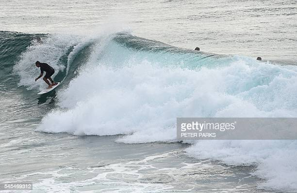 This photo taken on April 29 2016 shows surfers riding waves at Boulders Beach in Ballina in Northern New South Wales The Australian town of Ballina...