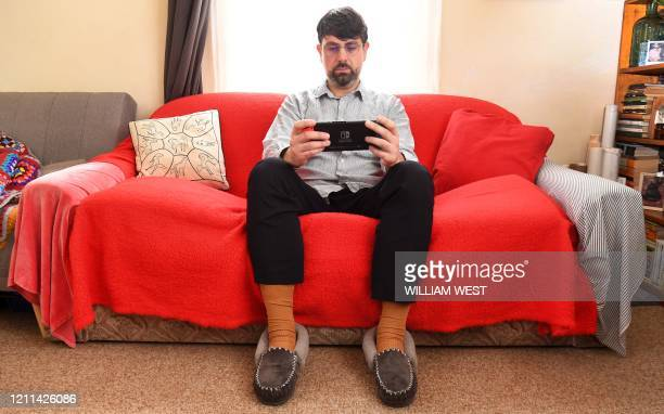 This photo taken on April 29, 2020 shows Australian high school teacher Dante Gabriele playing Nintendo's Animal Crossing at home in Melbourne during...