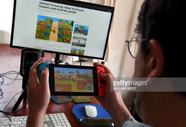 This photo taken on April 29 2020 shows Australian high school teacher Dante Gabriele playing Nintendo's Animal Crossing at home in Melbourne during...