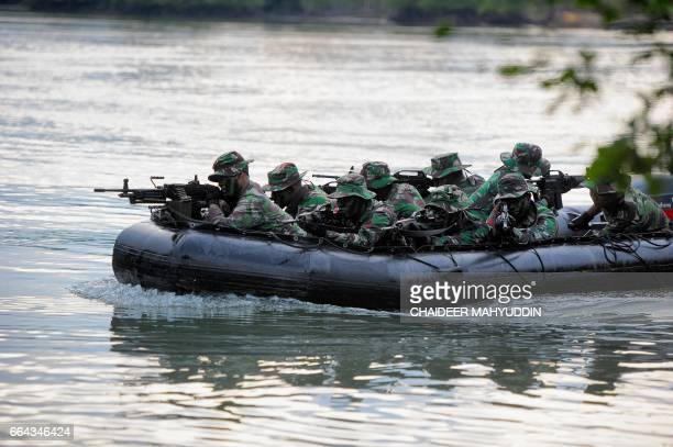 This photo taken on April 3 2017 shows Indonesia's antiterror military unit during a training exercise in Aceh Indonesia the world's most populous...