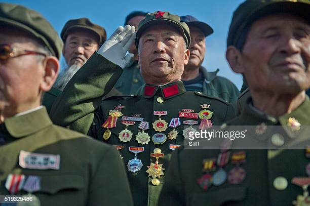 This photo taken on April 4 2016 shows Korean War veterans attending a memorial ceremony for Chinese People's Volunteer Army soldiers who died in the...