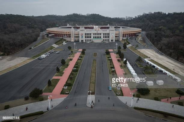 This photo taken on April 6 2017 shows a general view of the Kim IlSung stadium in Pyongyang / AFP PHOTO / Ed JONES