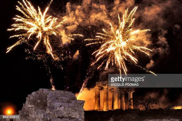 This photo taken on April 7 2018 shows fireworks exploding over the archaeological temple of Apollo in ancient Corinth near Athens as Greek Orthodox...