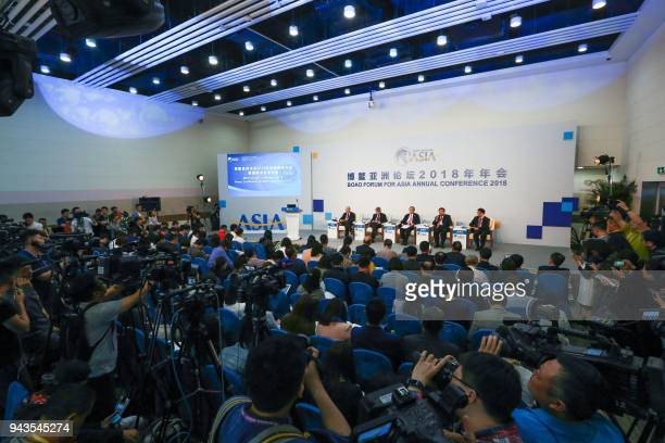 This photo taken on April 8, 2018 shows a press conference ahead of the opening of the Boao Forum for Asia International Conference in Boao, south...