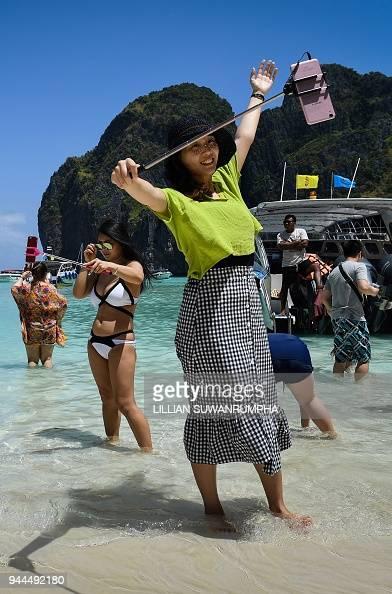 This photo taken on April 9, 2018 shows tourists taking