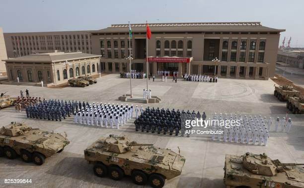This photo taken on August 1 2017 shows Chinese People's Liberation Army personnel attending the opening ceremony of China's new military base in...