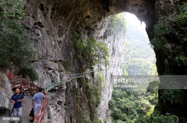 This photo taken on August 1 2017 shows the view of a glassbottomed skywalk at Shimenxian Lake in Rongan in southern China's Guangxi province The...