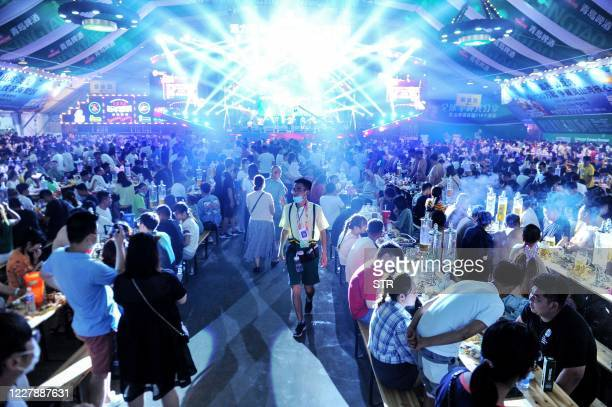 This photo taken on August 1, 2020 shows people enjoying beer and food during the annual Qingdao Beer Festival in Qingdao in China's eastern Shandong...