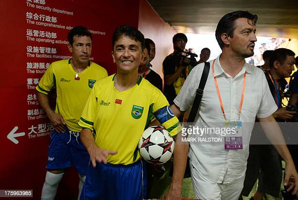 This photo taken on August 10 2013 shows football icons Careca and Bebeto of Brazil before the China and Brazil Legends game at the Olympic Stadium...