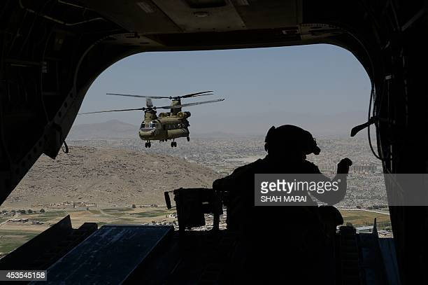 This photo taken on august 11, 2014 shows a US soldier, part of the NATO-led International Security Assistance Force , manning a machine gun onboard...